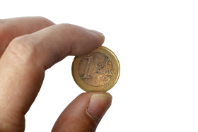 Stock Image: One euro coin in a hand isolated on a white background