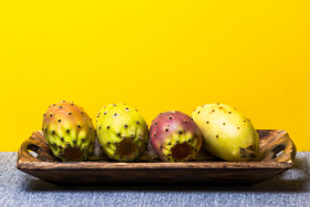 Stock Image: prickly pears yellow background