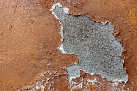 Stock Image: Red grunge weathered exterior wall texture