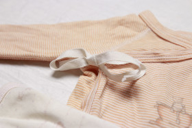 Stock Image: Ribbon on romper for babies
