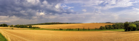 Stock Image: Rural landscape with a harvested wheat field in Germany near Velbert Langenberg, Neviges in North Rhine Westphalia