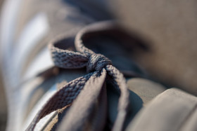 Stock Image: Shoelaces tied to the loop on the shoe