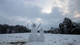 Snowmen built by children