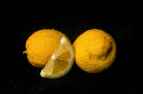 Stock Image: Wet Lemons on black background