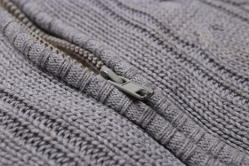 Stock Image: Zipper on Grey Wool Jacket for Kids